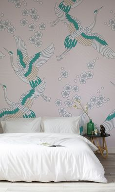 Elegant cranes take flight amongst cherry blossoms in this oriental wallpaper design. The pastel pink shade brings a feminine yet serene feel to your interiors, making it perfect for bedroom spaces.