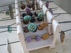 . . . this blog shares a very good tip re the hanging holes in pendants or beads . . .