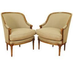 Pair of Carved, Painted and Upholstered Bergeres
