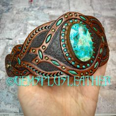 Welcome to see more pictures in my #etsyshop #Gemsplusleather where this stylish #cuff is listed as a sample 🙃#gemstonejewelry #handmade #chrysocolla #malachite #chrysocolla-malachite #gemsforall #leather #tooledleather #jewelry #leatherjewelry #leathercraft #Leatherwork #Handpainted #giftforher #artisan #artisanjewelry #leatherjewelry #handmadejewelry #bracelet #gemsforall Leather Ring, Leather Tooling, Leather Jewelry, Leather Craft, Tooled Leather, Tribal Jewelry, Boho Jewelry, Handmade Jewelry, Leather Gifts For Her