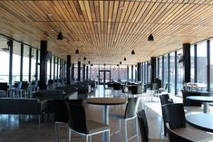 Incredible commercial application of stained cedar paneling. Ceiling Panels, Ceiling Lights, Cedar Paneling, Western Red Cedar, Wood Ceilings, Interior Walls, Building Materials, Wood Wall, Architecture