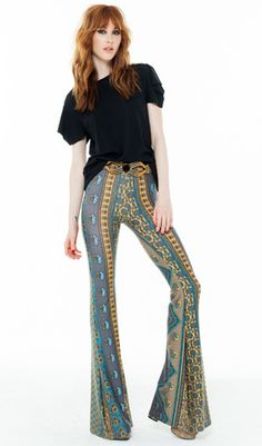 These ethnic stripe bell bottoms illustrate the theme perfectly. Neutrals combined with wild colors, vibrant patterns, and of course the 70s.
