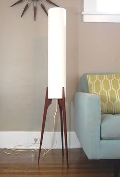 Cool mid century modern teak tripod floor lamp from the 1960s. This rocket ship like design is attributed to Fog & Morup. The lamp shade is newly