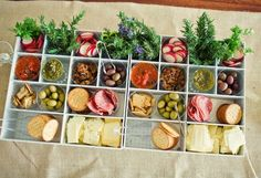 Boxes compartmentalizing food - great for outdoor picnic or cocktail reception