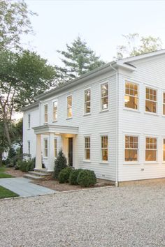 There's such a thing as having too many options for white paint. If you're on the fence, Benjamin Moore White Dove paint always makes a safe option. White Farmhouse Exterior, White Exterior Paint, White Exterior Houses, Exterior Paint Colors For House, Paint Colors For Home, Exterior Colors, Colonial House Exteriors, Painted Brick Exteriors, Colonial Exterior