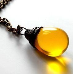 citrine yellow glass teardrop pendant - hangs on brass 18 inch chain...  looks like a drop of honey.