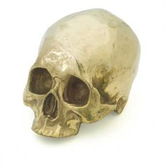 A bronze skull without a jaw bone.