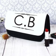 Our Initials makeup bag is a wonderfully unique gift for her.  Personalise with initials up to 3 characters including spaces and punctuation.  Personalisation will appear in UPPER CASE.  Please refrain from using special characters as this may impair the quality of the personalisation.   Our makeup bags features a main compartment and two separate compartments inside all of which are secured with a Velcro close, the main body of the bag is a woven polyester.  A great gift for Mother's Day…