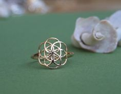 Hey, I found this really awesome Etsy listing at https://www.etsy.com/listing/202535475/small-flower-of-life-ring-14k-yellow