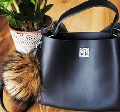 fur pendant  by GENA is perfect for your bag!