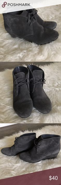 Nine West suede booties Closet staple wedge booties by Nine West. Classic gray suede with two laces. Wedge height 1 3/4. Some wear but nothing major. Perfect for fall and winter! Nine West Shoes Ankle Boots & Booties