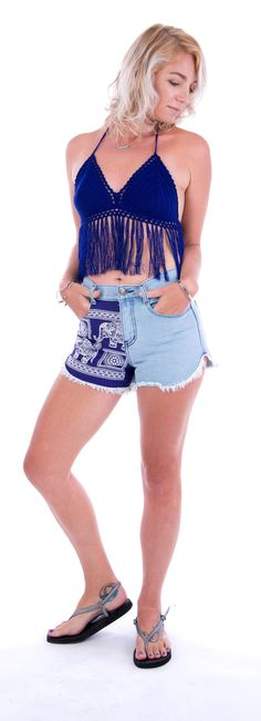 85a7813f0 Team these purple denim shorts with blue tassel crochet top for your winter  vacation! Purple