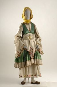 "19th-20th century, Inv. No. 5149 Called chrysi foresia (gold costume), this bridal costume differs from others worn in Thessaly. Located at the tip of the Pelion peninsula, Trikeri's interaction with the islands, chiefly the Northern Sporades, was responsible for the Skyriot features in its attire. This wedding costume consists of two white chemises and as many as thirteen petticoats. The ""good"" outer chemise is of varicolored linen or silk cloth and embroidered in gold or polychrome silks…"