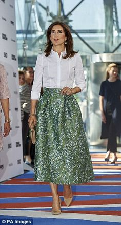 Princess Mary (pictured) was pictured wearing the same H&M dress as another Copenhagen Fashion Summit attendee