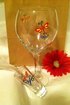 Hand painted dragonfly wine glass and shot glass by Samantha Blair.
