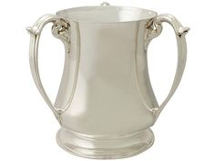 'Antique Sterling Silver Trophy Cup' http://www.acsilver.co.uk/shop/pc/Sterling-Silver-Presentation-Champagne-Cup-Art-Nouveau-Style-Antique-Edwardian-52p8850.htm
