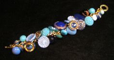 Button bracelet made from vintage buttons shades of blue glass Victorian, Art Deco, and 1950's buttons. $88.00, via Etsy.