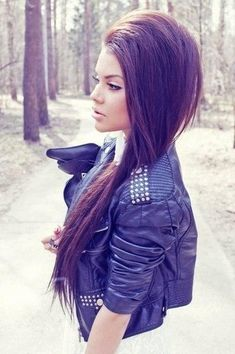 Pumped dark long hair, straight w/ volume and pulled to side. Liner nude lips, leather jacket for edge