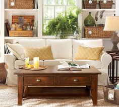 Pottery Barn Living Room with baskets and wooden case bar