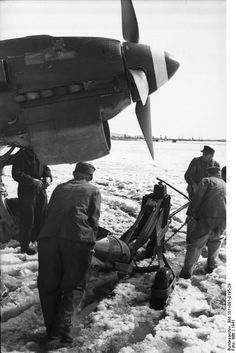 German armorers loading a bomb onto a Ju 87 Stuka dive bomber, Norway, 1941