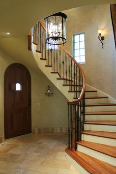 Amazing spiral staircase with gorgeous wooden treads. The large lantern falls perfectly in the middle of the stairs, lighting up the whole staircase.