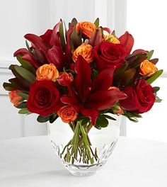 Thanksgiving Flowers and Gifts. Send flowers and gifts from our Thanksgiving Flowers and Gifts section using local florists and bakeries and with our low service fee. Burgundy Flowers, Fall Flowers, Red Roses, Fall Flower Arrangements, Floral Centerpieces, Thanksgiving Flowers, Fresh Flower Delivery, Flower Company, Spray Roses