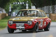 Photo gallery, race results and report from the 2013 Goodwood Festival of Speed, held July at the Goodwood hill climb in England. Sports Car Racing, Sport Cars, Race Cars, Auto Racing, Escort Mk1, Ford Escort, Ford Rs, Car Ford, Ford Motor Company