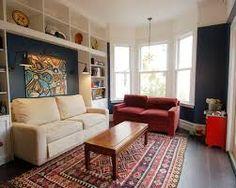 Картинки по запросу small living room wall shelves at head height all around the room
