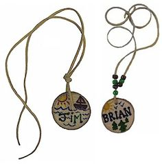 Camp Name Necklaces, circles are just pieces of rough wood, kids can write their names and add beads to it.