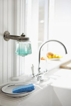 Spotted on Design Sponge: a vintage soap dispenser repurposed as dishsoap holder in the Brooklyn home of photographer Alexandra Grablewski and painter Todd Bonné. Dish Soap Dispenser, Wall Mounted Soap Dispenser, Soap Holder, Ikea Hacks, Home Kitchens, Kitchen Decor, Soap Kitchen, Diy Kitchen, Kitchen Sink
