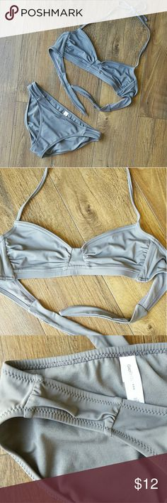 Gap bikini Suit is in great condition, only worn a couple of times.  The only flaw is that I lost the removable cups that came in the top.  The bust does have 3 layers of fabric in all though so there's still a decent amount of lining.  Cute seaming and ruching details on top and bottom.  Chic grey color.  Top and bottom both xs.  BUNDLE FOR DISCOUNT! GAP Swim Bikinis