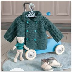 This is a free pattern (in French) for a knitted toddler cardi, but it ought to be possible to make something similar in crochet
