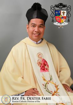 The Coat of Arms of REV. FR. DEXTER FABIE., Cleric of the Diocese of Iba, Priest-Son of the Parish of San Sebastian, Poblacion, San Narciso, Zambales. Currently Parish Priest of the Parish of San Nicolas de Tolentino, San Juan, Castillejos, Zambales. In honor of his Tenth Presbyteral Anniversary last March 2, 2018. Designed by: Kendrick Ivan B. Panganiban Copyright: DOMVS AVREA 2018.