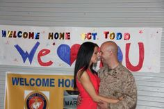 "Sgt. James D. Todd, an individual material readiness list asset manager with Marine Tactical Electronic Warfare Squadron 1, holds his wife, Mollie, after returning from a seven-month deployment to Italy and Afghanistan during the VMAQ-1 homecoming outside the squadron's hangar, April 4. ""What drove me to get home safely was the support of my beautiful wife,"" said Todd. ""It is an awesome relief to finally be back. It has been a long time coming. While we were there we did our job to the best of o"