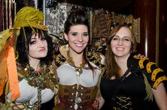 Michelle from Damsel In This Dress (far left) is wearing Dreadful Falls, USA's Monarch Butterfly Ribbon Falls at the Steampunk Symposium @ The Queen Mary - LA Weekly