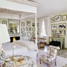 An array of leafy 19th-century botanical prints and a delicate chintz fabric in the master bedroom add naturalistic life and color | archdigest.com