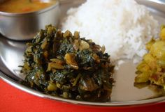A favorite spinach stir fry prepared with just a handful of ingredients to bring out a delicious amalgamation of flavors. A mildly spiced dish with garlicky overtones.