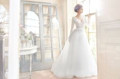 Style 2700  Tara Keely by Lazaro bridal gown - Ivory sparkle tulle bridal ball gown, Long sleeve Venise lace bodice with cashmere lining and V neckline, Scalloped peplum detail with ribbon accenting the natural waist, deep V back, Tulle skirt with horsehair hem detail and chapel train.