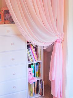 Instead of closet doors, which could pinch little fingers, Rate My Space user CentsationalGirl opted for a perfectly girly pink velvet curtain, which can be pulled back to provide access to favorite books and toys or drawn to conceal clutter.
