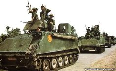 The soldiers of the Army of the People's Republic of Vietnam, with their captured American Armored Personnel Carriers (M-113s), in Kampuchea (Cambodia)