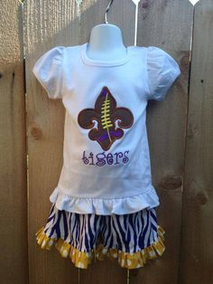 Smock Your Tot - Purple Tiger Stripe Shorts with Appliqued Purple and Gold Fleur de Lis football Shirt or Onesie, $38.95 (http://www.smockyourtot.com/purple-tiger-stripe-shorts-with-appliqued-purple-and-gold-fleur-de-lis-football-shirt-or-onesie/)