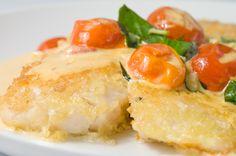 Parmesan Crusted Tilapia with Tomato-Basil Cream Sauce.