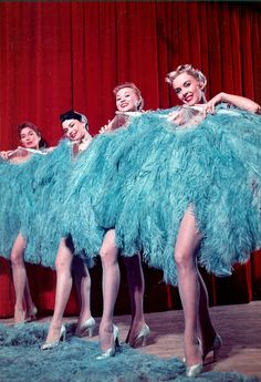 """Four Copa Girls pose onstage with oversized blue ostrich feather fans; they stand in front of a red curtain for a show at the Sands Hotel in Las Vegas, circa From the UNLV Libraries """"Showgirls"""" digital collection. Costumes Burlesques, Burlesque Costumes, Cabaret, Las Vegas Show Girls, Las Vegas Shows, Showgirl Costume, Vegas Showgirl, Burlesque Show, Vintage Burlesque"""