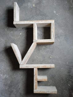 """Love"" Bookshelf! Very sweet idea, could easily DIY with access to a saw."