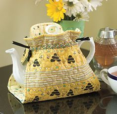Love this idea. A quilted one that doesn't have to come off every time you want to pour a cuppa.