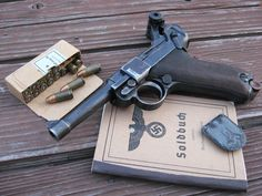 """nazi soldier standard posesions:   a Luger P08 (Parabellum) pistol , bullets , """"soldier's book"""" and a nazi pin"""