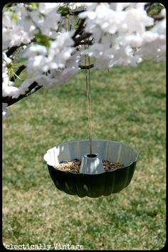 well shoot, why'd I throw away that old bundt pan? Drill some holes in the bottom for water to pass through and add a pie tin for the top and this is an awesome bird feeder at a fraction of the cost.
