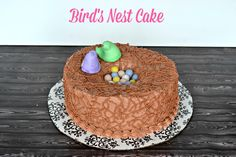 Easter Bird Nest Cake is a carrot cake topped with buttercream frosting, chocolate eggs, and Peeps! Cadbury Chocolate Eggs, Chocolate Frosting, Round Cake Pans, Round Cakes, Carrot Cake Topping, Brown Food Coloring, No Egg Desserts, Easter Candy, Cake Decorating Tips