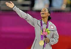US gymnast Gabrielle Douglas acknowledges the crowd after receiving her gold medal on Thursday