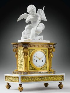 A GILT-BRONZE MOUNTED PARIS PORCELAIN AND BISCUIT MANTEL CLOCK BY THE MANUFACTURE OF DIHL ET GUÉRHARD, LATE LOUIS XVI, Circa 1790 - Dim: H. 50 cm, W. 31,5 cm, D. 19 cm // Height 19 2/3 in; width 12 1/2 in; depth 7 1/2 in